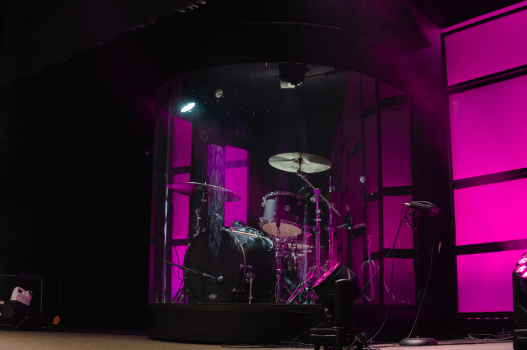 Magenta lighting on the Crystal clear drum case designed by Whiteley.